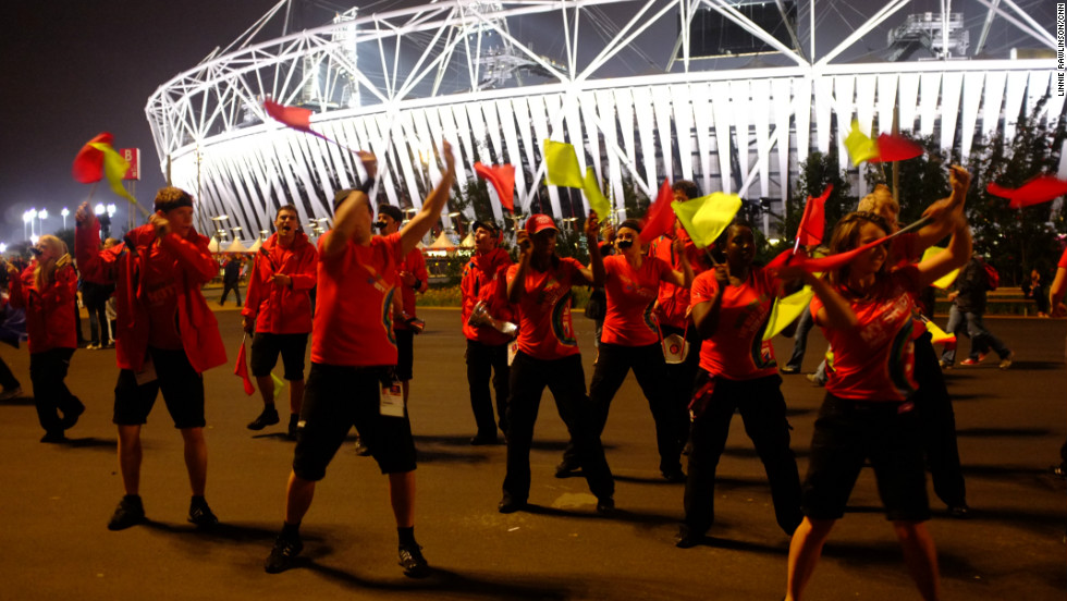 Once the evening's athletics had finished, crowds poured from the Olympic Stadium. Dancers guided the crowds towards the exits and wished them a safe journey home.