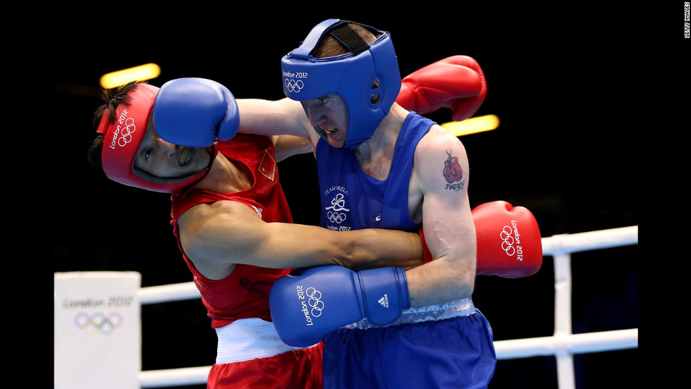 Ireland's Paddy Barnes delivers a punch against Shiming Zou of China during the men's light flyweight (49-kilogram) boxing semifinal bout.