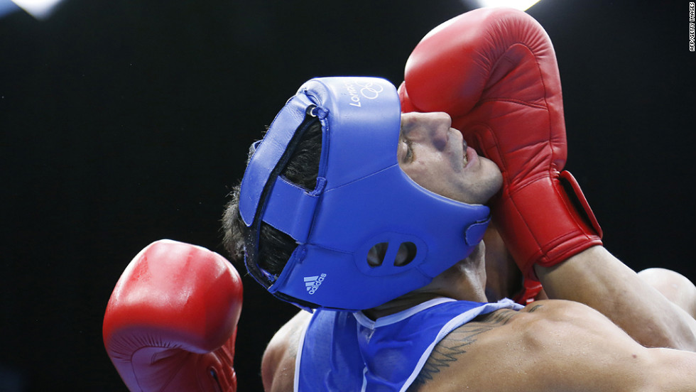 Italy's Vincenzo Mangiacapre, left, faces off against Roniel Iglesias Sotolongo of Cuba in the men's light welterweight (64-kilogram) boxing semifinals.