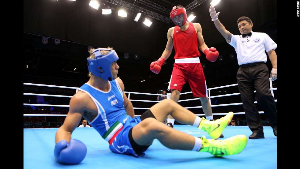 Azerbaijan's Teymur Mammadov stands over Italy's Clemente Russo during the men's heavyweight  boxing bout.