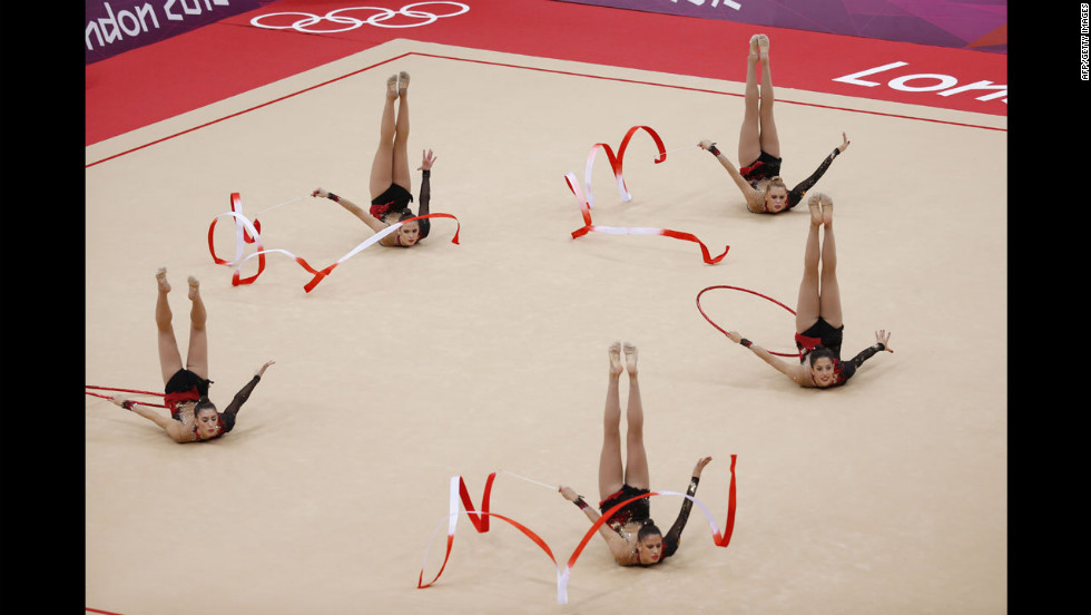 Spain's rhythmic gymnastics team performs in the group all-around qualifications.