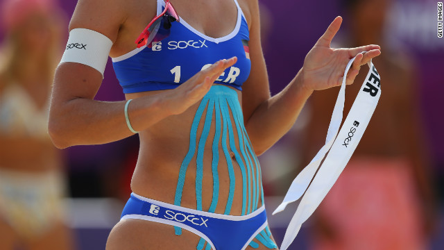 Katrin Holtwick of Germany is taped during the Olympic women's beach volleyball match between Germany and Czech Republic.