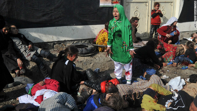The world's attention was caught by the pain of the girl in the green dress. Behind her in a yellow dress is Fatima and lying in the pile of victims is Gulmina.