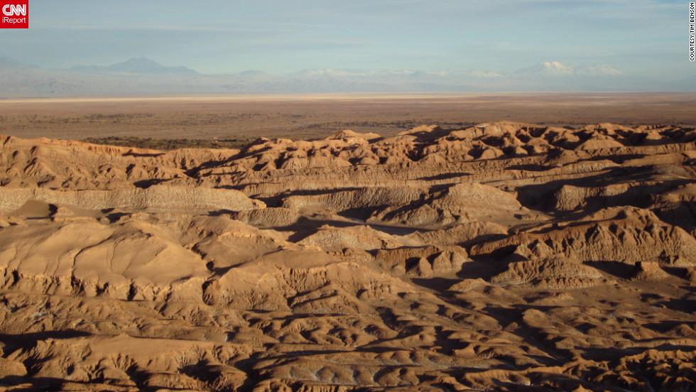 "The view of Chile's Atacama Desert at sunset reminded <a href=""http://ireport.cnn.com/docs/DOC-825759 "">Tim Benson</a> of Mars, ""with the red coloring of the stone and the vast isolation and absence of life. Very moving, very serene, it felt as though we had departed the world."""