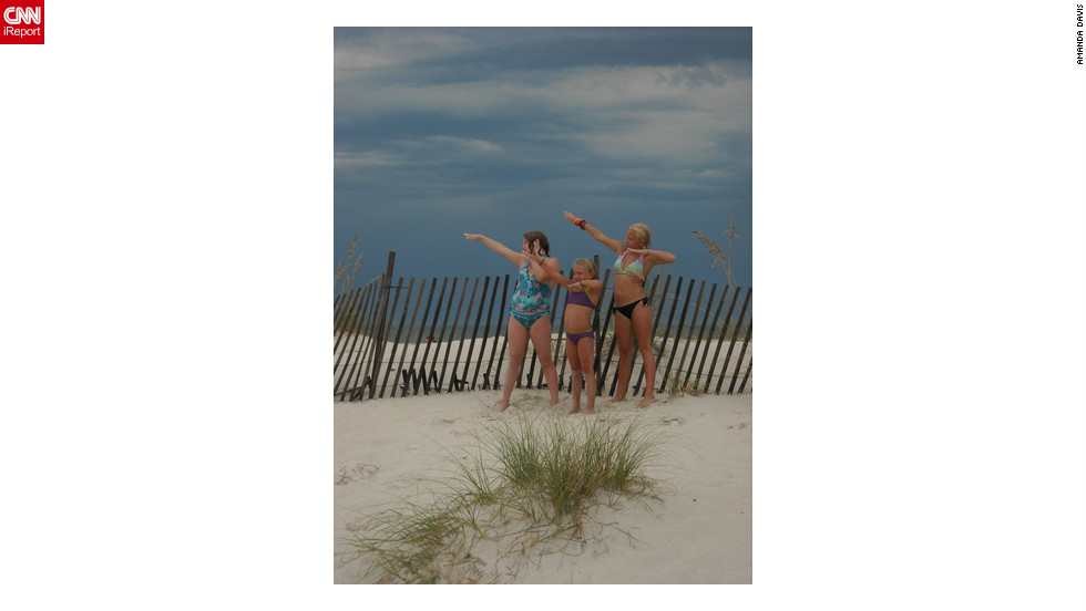 "While on vacation to Gulf Shores, AL, Amanda Davis says she asked her daughters to strike a pose for the camera and they spontaneously did the signature 'Bolt' pose. ""Just like planking or Tebowing, it's just plain fun,"" she says. ""My oldest daughter loves track and thinks Usain Bolt is an amazing and talented athlete."""
