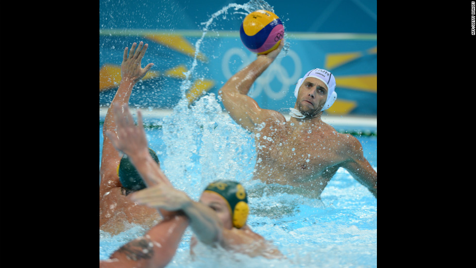 Hungary's Tamas Kasas passes the ball during the men's water polo classification 5-8 between Hungary and Australia.