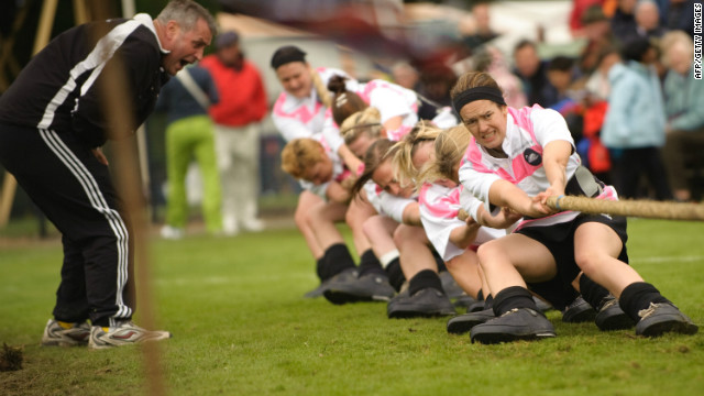 BRAEMAR, UNITED KINGDOM - SEPTEMBER 05: Servicewomen of the 9th Signal Regiment compete in a 'tug of war' contest at the 2009 Braemar Highland Games on September 5, 2009 in Braemar, United Kingdom. (Photo by Martin McNeil/Getty Images)