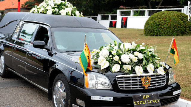 A hearse carries the body of late Ghanaian president John Atta Mills to the parliament in Accra on Wednesday.