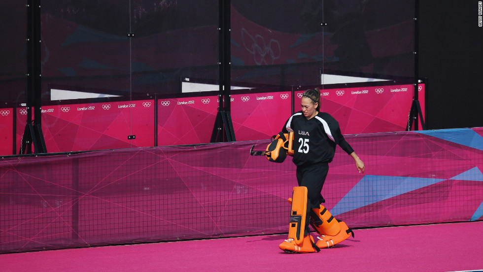 "U.S. goalkeeper Amy Swensen walks off the pitch after being substituted for an offensive player in the last minutes of the women's field hockey classification match between the United States and Belgium. Check out<a href=""http://www.cnn.com/2012/08/11/worldsport/gallery/olympics-day-fifteen/index.html"" target=""_blank""> Day 15 of the competition </a>from Saturday, August 11."