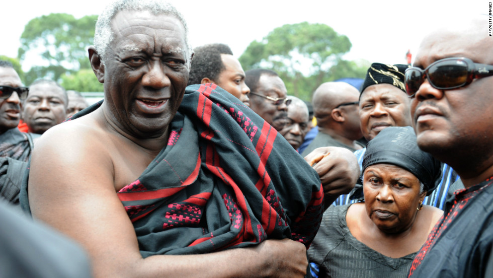 Former Ghanaian president John Kufuor arrives to pay respect to Mills at the parliament in Accra on Wednesday.