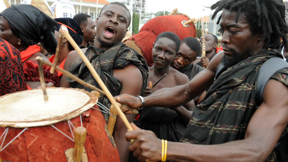 A mourner plays his drum amid a long queue of people gathered Thursday to pay respects to Ghana's late president.
