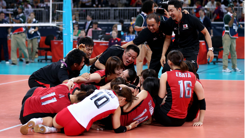 Japanese volleyball players celebrate after their win over South Korea in the women's volleyball bronze medal match.