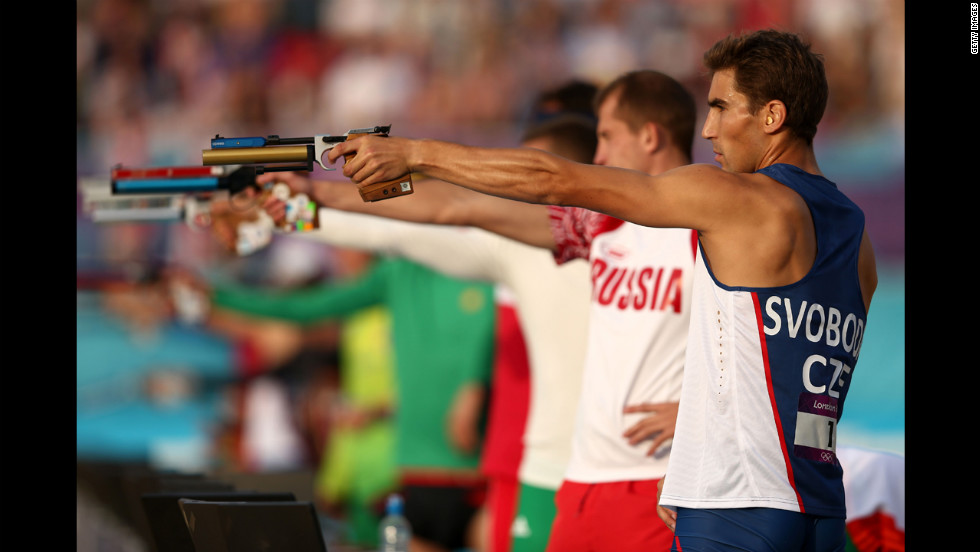 David Svoboda, right, of Czech Republic competes in the combined running and shooting event in the men's modern pentathlon.