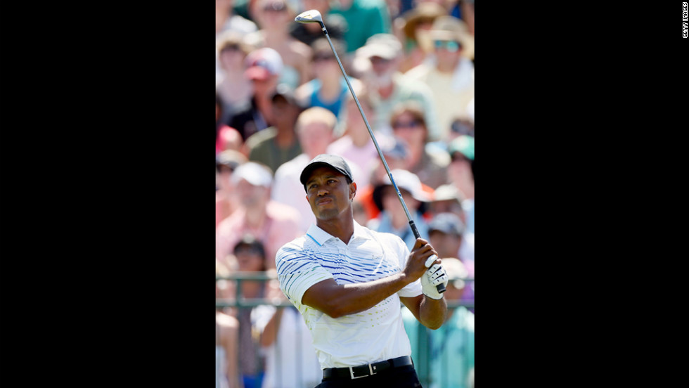 Tiger Woods of the United States hits off the first tee.