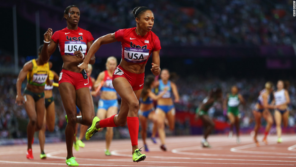 Allyson Felix receives the relay baton from DeeDee Trotter during the women's 4x400-meter relay final.