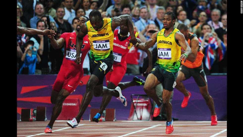 Usain Bolt of Jamaica receives the relay baton from Yohan Blake of Jamaica next to Tyson Gay of the United States during the men's 4x100-meter relay final.