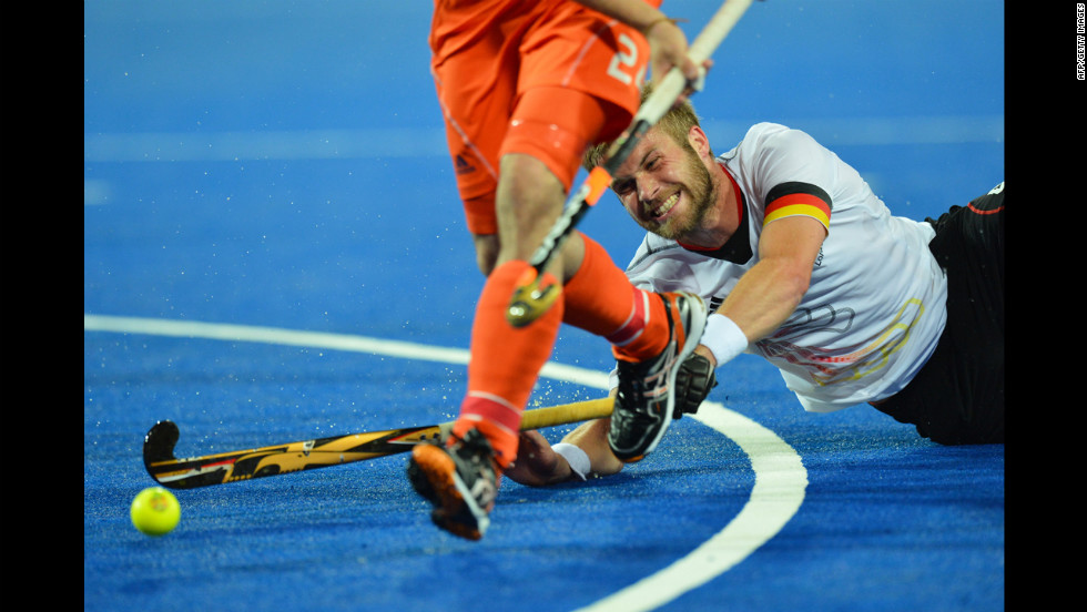 Germany's Maximilian Mueller vies for the ball during the men's field hockey gold medal match between Germany and the Netherlands.