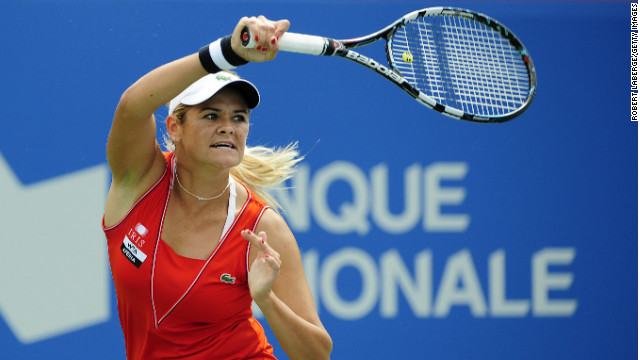 Aleksandra Wozniak of Canada returns to Christina McHale during the third round at the Rogers Cup