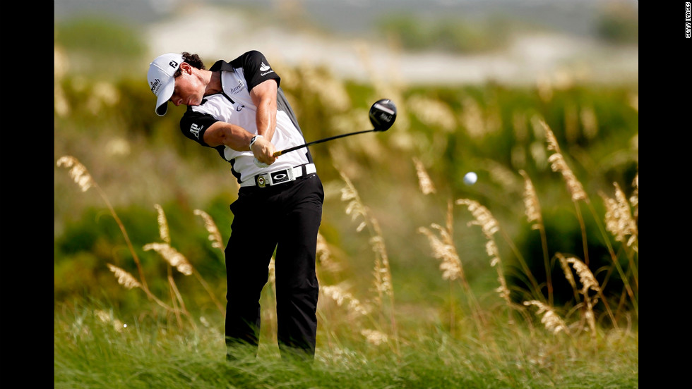 Rory McIlroy of Northern Ireland, who goes into Sunday's play in the lead at 6 under par, hits off the sixth tee.