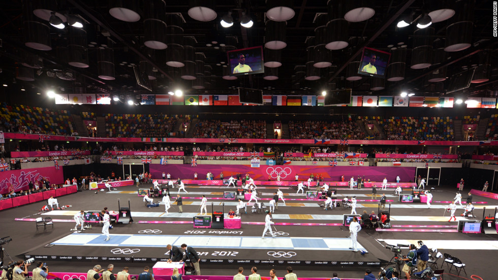 Athletes compete in fencing during part of the modern pentathlon.