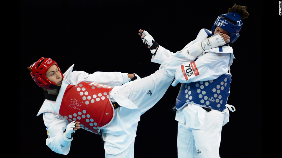 Maryna Konieva of Ukraine, left, competes against Nadin Dawani of Jordan during the women's +67-kilogram taekwondo preliminary round. Konieva defeated Dawani to advance to the quarterfinals.