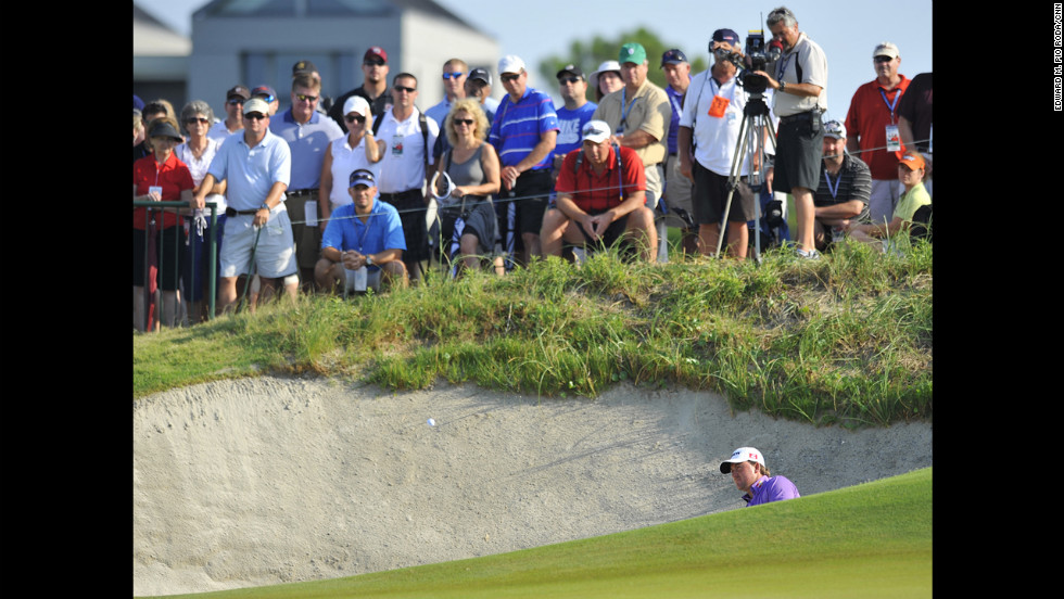 Graeme McDowell blasts out of a sand bunker on Sunday.