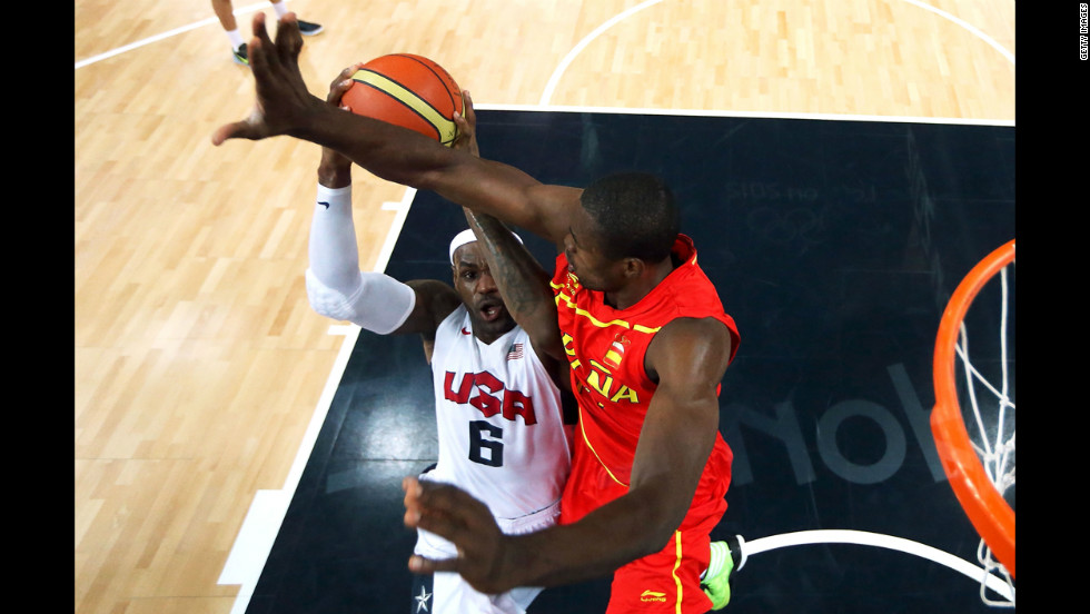 LeBron James goes up for a shot as Serge Ibaka of Spain attempts to block.