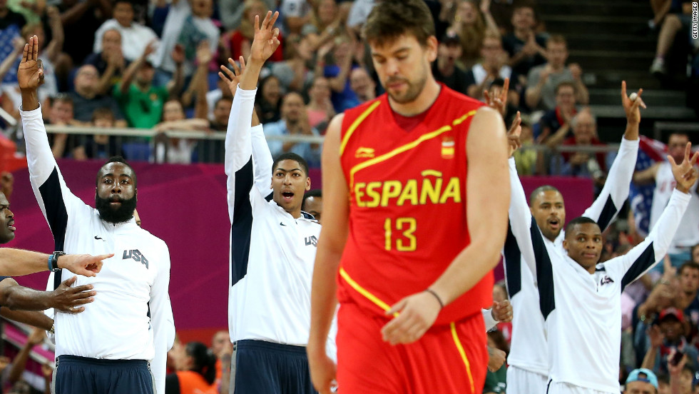 With victory in sight, U.S. players players come off the bench near the game's end as Marc Gasol of Spain walks off.