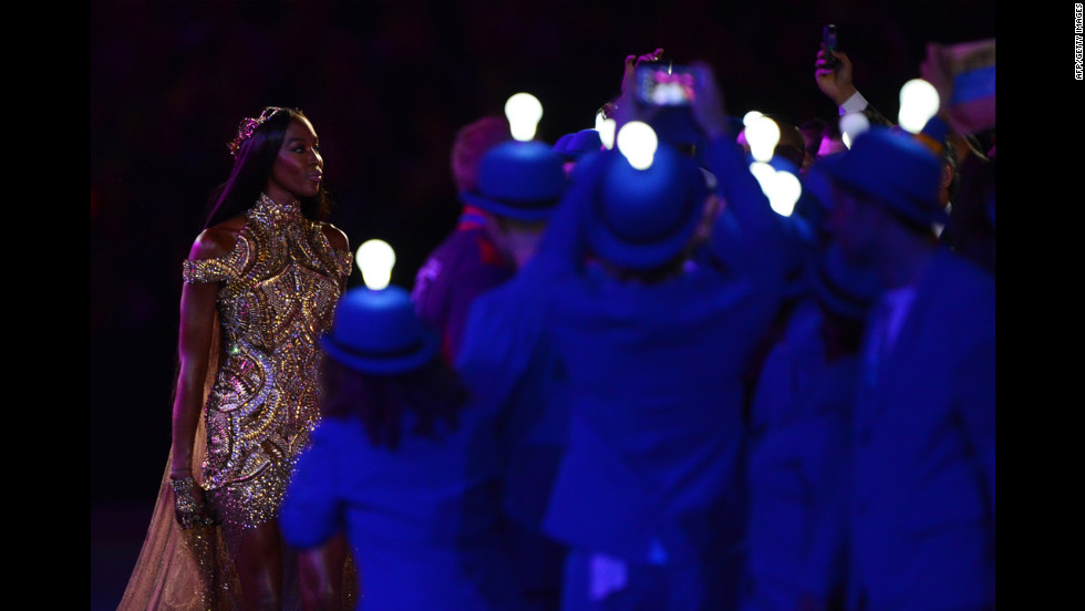 British model Naomi Campbell, left, performs during the fashion segment of the ceremony.