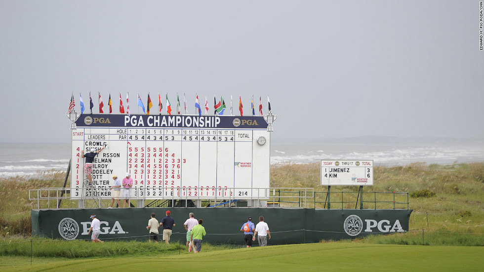 Changes are made to the leaderboard during a delay in play due to weather Saturday.