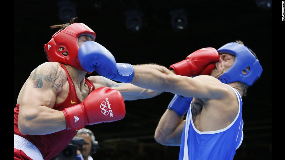 "Oleksandr Usyk of the Ukraine, in red, defends against Clemente Russo of Italy, in blue, during the heavyweight boxing final. Usyk won gold on a 14-11 points decision on Day 15 of the London 2012 Olympic Games on Saturday, August 11. Check out the best images from <a href=""http://www.preview.cnn.com/2012/08/10/worldsport/gallery/olympics-day-fourteen/index.html"" target=""_blank"">Day 14 of competition</a> on Friday, August 10. The Games ran through Sunday, August 12."