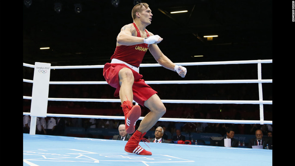 Aleksandr Usyk of Ukraine celebrates his gold medal victory over Clemente Russo of Italy in the Heavyweight (91kg) boxing final.