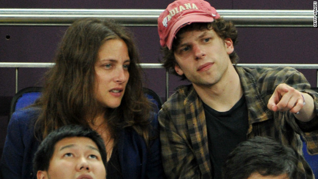 Actor Jesse Eisenberg, right, was in London watching Sunday's gold-medal hoops game between Spain and the United States.