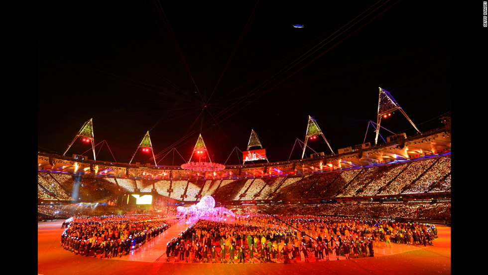 The athletes of the competing nations enter the stadium.