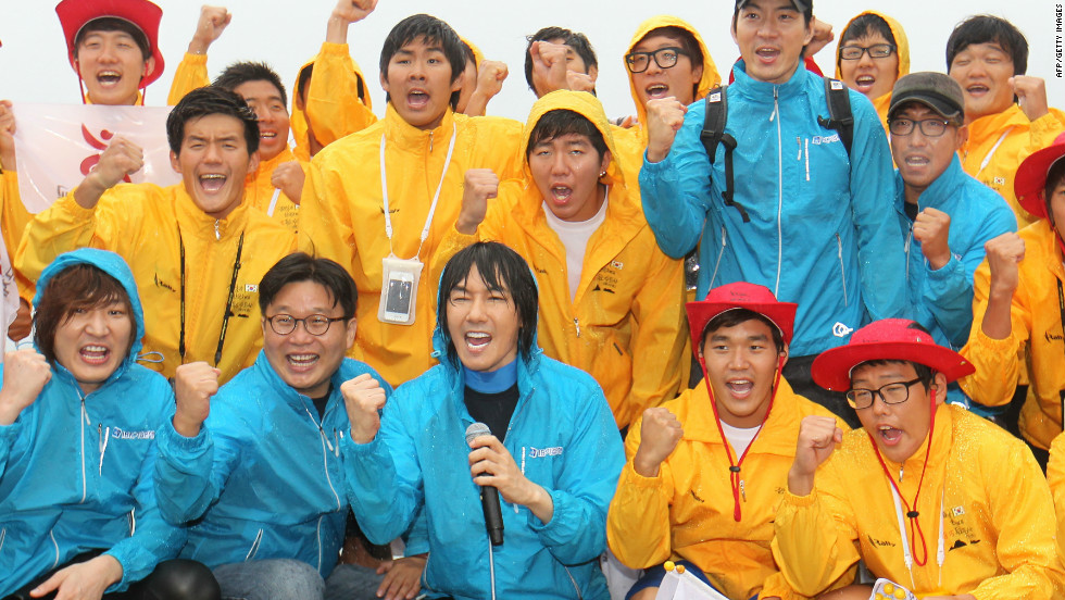 South Korean singer Kim Jang-Hoon (front) and members of a swimming club pose for a group photo before embarking on a 55-hour-long relay swim to the contested islands. They're due to arrive on Wednesday, August 15, the 67th anniversary of Korea's independence from Japanese colonial rule.