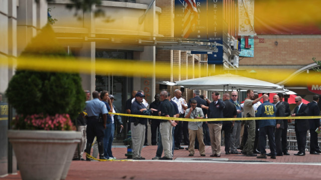 Local and federal investigators work to gather evidence after a security guard was shot in the arm at the headquarters of the Family Research Council on August 15, 2012 in Washington.