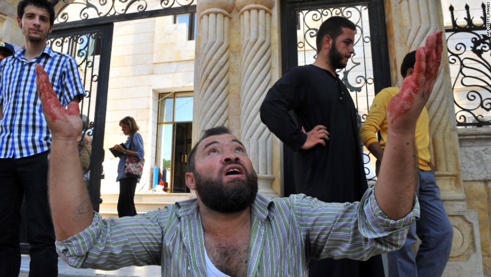 A Syrian man reacts after an airstrike in Azaaz.
