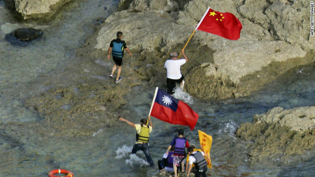 Activists carry Chinese and Taiwanese flags on the disputed island on Wednesday.