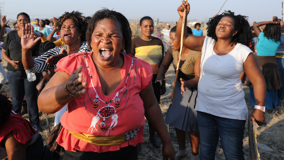 Protesters gather at the Lonmin platinum mine in Marikana, South Africa on August 17, 2012 where the day before 34 people were killed when police opened fire on striking mineworkers.