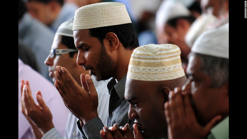 Sri Lankan Muslims take part in communal Friday noon prayers in Colombo.