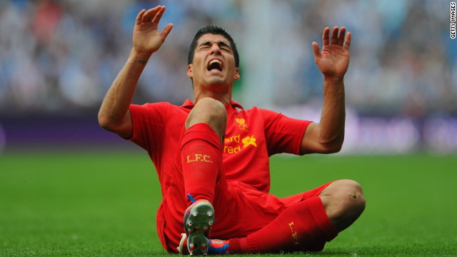 Luis Suarez reacts to a tackle in Liverpool's 3-0 defeat to West Bromwich Albion