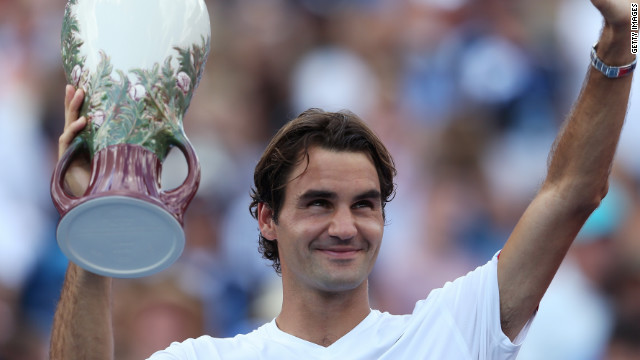Roger Federer holds the Cincinnati Masters trophy aloft after his superb final victory over Novak Djokovic.