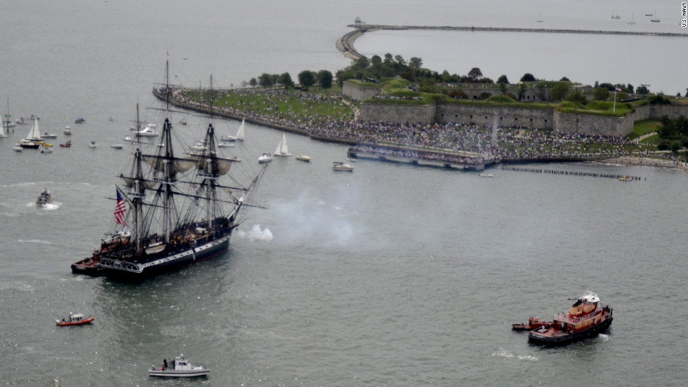 The USS Constitution fires a 21-gun saulte toward Fort Independence on Castle Island.