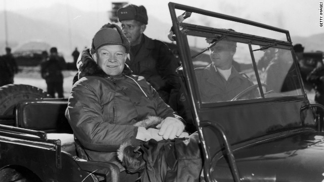 President Elect Dwight Eisenhower (1890 - 1969) and General Mark Clark (back seat, 1896 - 1984), in a jeep during their tour of installations of the 2nd US Infantry Division on a visit to United Nations units along the fighting front during the Korean War, Korea. (Photo by Hulton Archive/Getty Images)