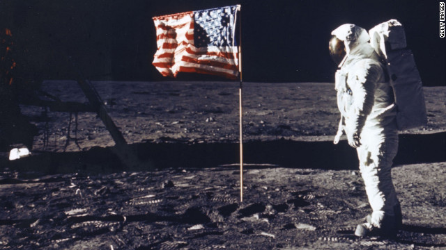 Astronaut Edwin E. Aldrin Jr. Poses For A Photograph Beside The Deployed Flag Of The United States. The Lunar Module Is On The Left. Man's First Landing On The Moon Occurred Today At 4:17 P.M. July 20, 1969 As Lunar Module 'Eagle' Touched Down Gently On The Sea Of Tranquility On The East Side Of The Moon. The Lm (Lunar Module) Landed On The Moon On July 20, 1969 And Returned To The Command Module On July 21. The Command Module Left Lunar Orbit On July 22 And Returned To Earth On July 24, 1969. Apollo 11 Splashed Down In The Pacific Ocean On 24 July 1969 At 12:50:35 P.M. Edt After A Mission Elapsed Time Of 195 Hrs, 18 Mins, 35 Secs. (Photo By Nasa/Getty Images)