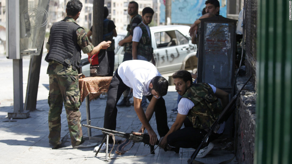 Members of the Free Syrian Army prepare their weapons in Aleppo's Saif al-Dawla district on Monday, August 20.