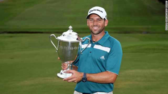 Sergio Garcia takes hold of the Sam Snead Cup following his first win at a PGA Tour event since 2008.