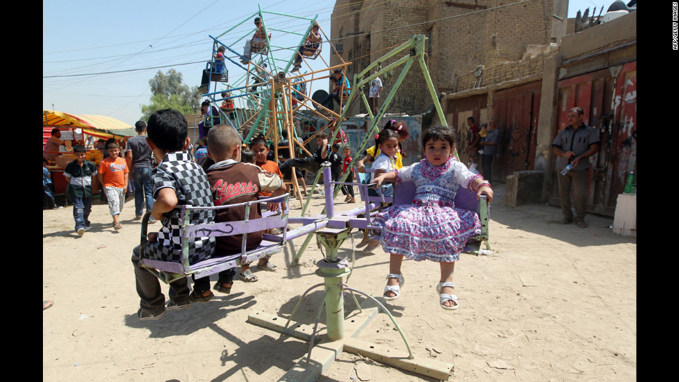 Children visit an amusement park in Baghdad during the Eid al-Fitr holiday on Monday.