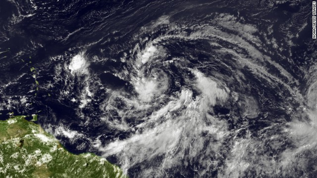 n this handout satellite mage provided by National Oceanic and Atmospheric Administration (NOAA), an area of low pressure located about 1000 miles east of the Lesser Antilles moves westward at 20 to 25 mph on August 20, 2012 in the Atlantic Ocean. With less than one week until the Republican National Convention starts this system has a high chance of becoming a tropical cyclone during the next 48 hours and is expected to grow into Isaac, the ninth named tropical storm of the season according to NOAA. Currently there is no direct threat to Tampa Bay, Florida where thousands are expected to attend the convention that starts August 27.