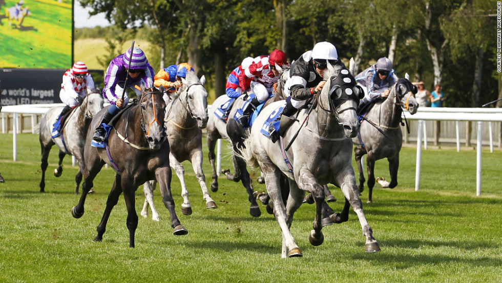 Medici Time under jockey Eddie Ahern won the annual gray horses handicap race held at the famous Newmarket race course in England in August 2012. <br />